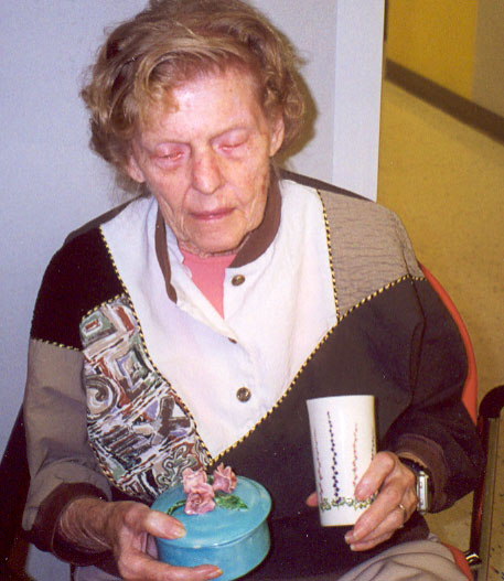 Jean at GuildCare showing ceramics she made in 1948